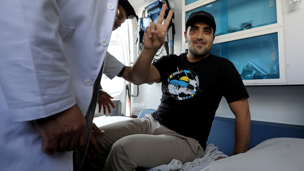 Jordanian citizens Abdul Rahman Miri gestures upon his release by Israel, at the King Hussein Bridge crossing near Amman