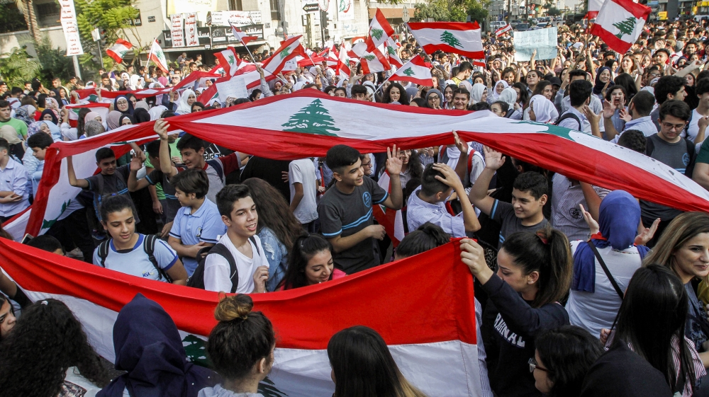Lebanon students skip school as protesters eye state institutions