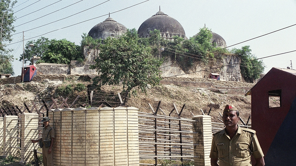 Indian security forces guard the Babri Mosque in Ayodhya, Oct. 29, 1990, closing off the disputed site claimed by Muslims and Hindus. The dispute is at the center of a major religious and political st