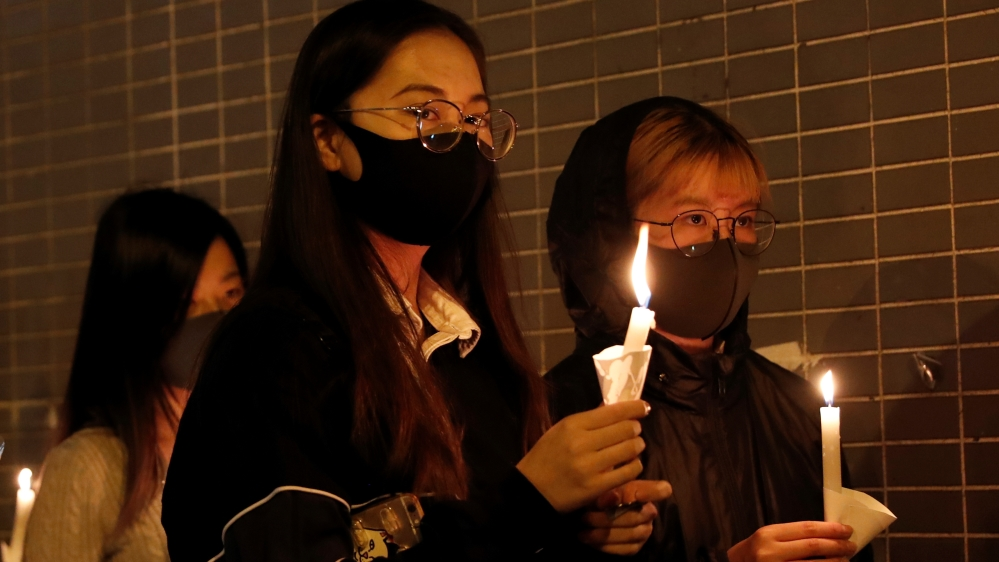 Anger in Hong Kong over student's death as thousands hold vigils