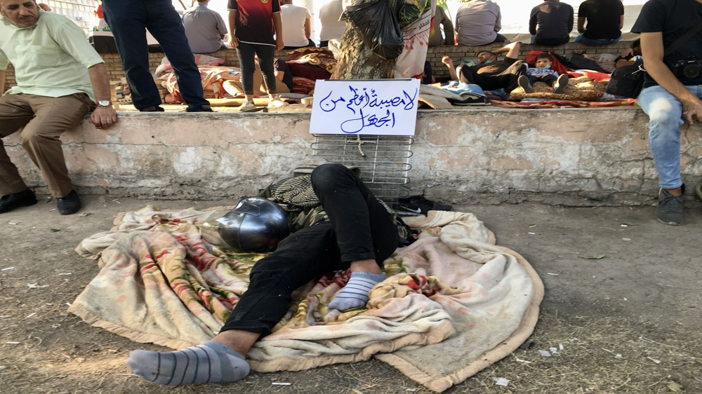 A sign at a sit-in site in Baghdad reads: