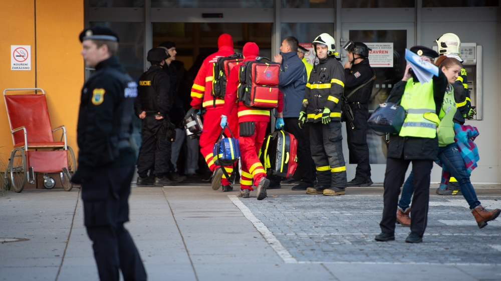 Rescuers enter a hospital after a shooting incident, in Ostrava, Czech Republic, 10 December 2019. According to police, at least six people have been killed in a shooting at a hospital in Ostrava. The