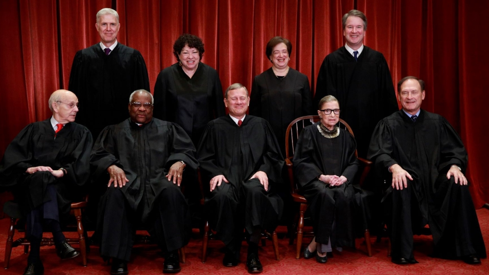 U.S. Supreme Court justices pose for their group