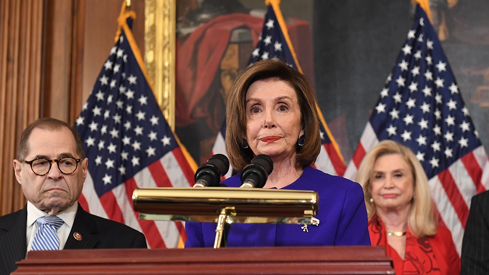 House Speaker Nancy Pelosi (D-CA) speaks next to House Judiciary Chairman Jerry Nadler(L), Democrat of New York, House Permanent Select Committee on Intelligence as they announce articles of impeachme