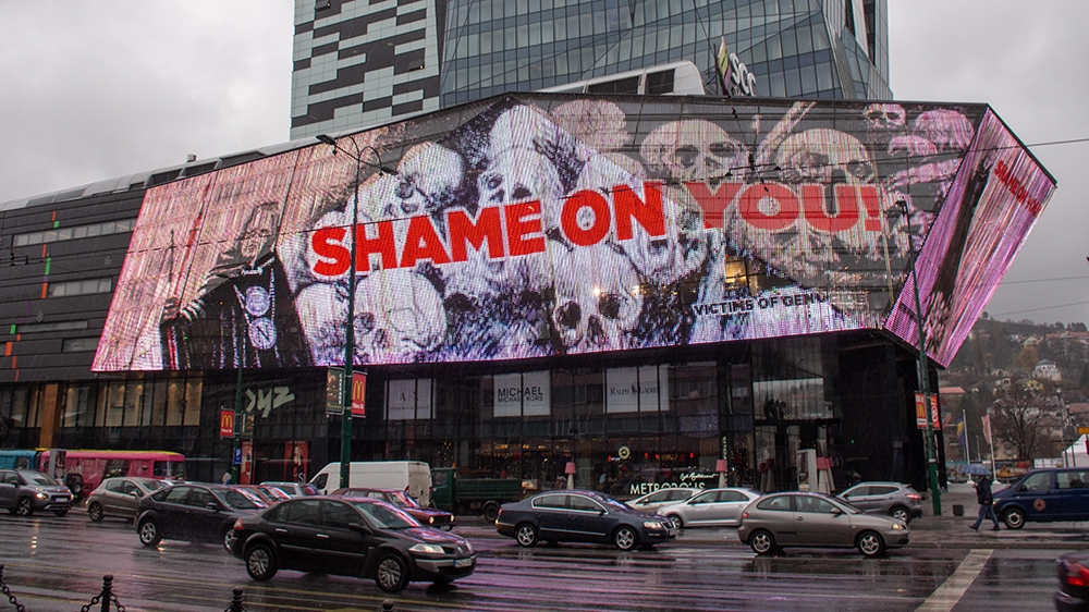 SARAJEVO, BOSNIA AND HERZEGOVINA - DECEMBER 10: A visual, written 'shame on you' is reflected to a giant screen on a shopping mall's wall to protest against the awarding of Nobel Literature prize to A