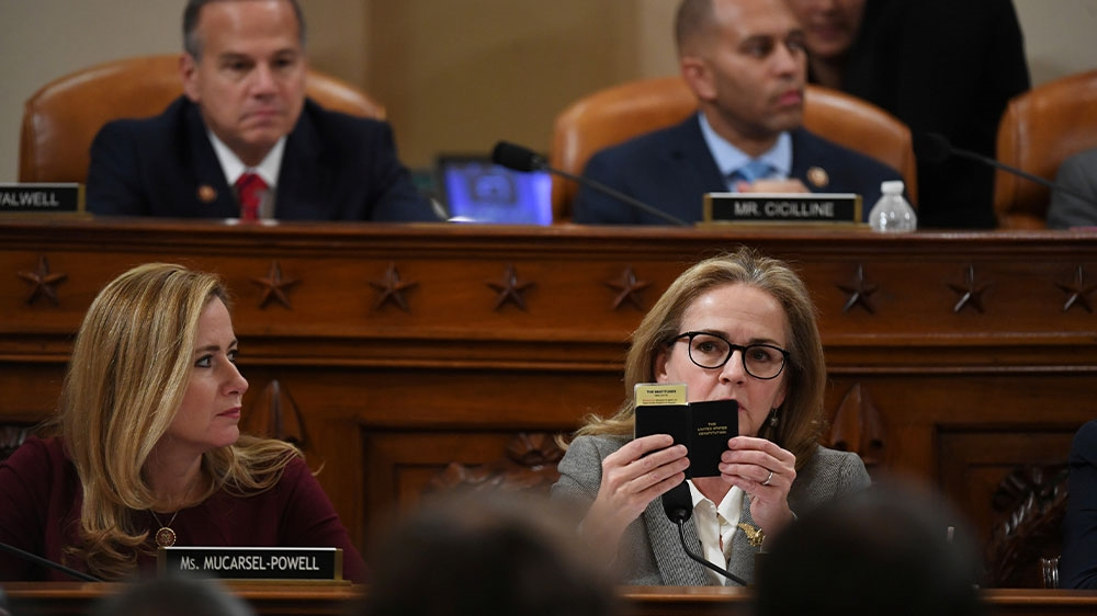 US Representative Madeleine Dean holding up a copy of the constitution during a House Judiciary Committee markup of articles of impeachment against President Donald Trump at the Longworth House Office Building in Washington, DC, US [Matt McClain/Pool via Reuters]