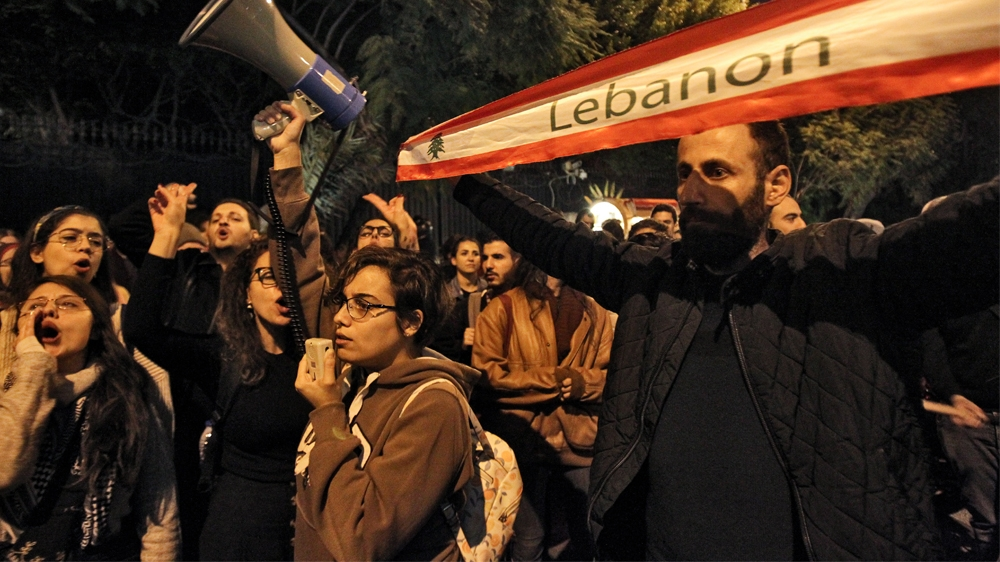 LEBANON-POLITICS-DEMO  Protesters chant slogans as they march during a demonstration outside the Interior Ministry headquarters in the Lebanese capital Beirut on December 11, 2019. IBRAHIM AMRO / AFP
