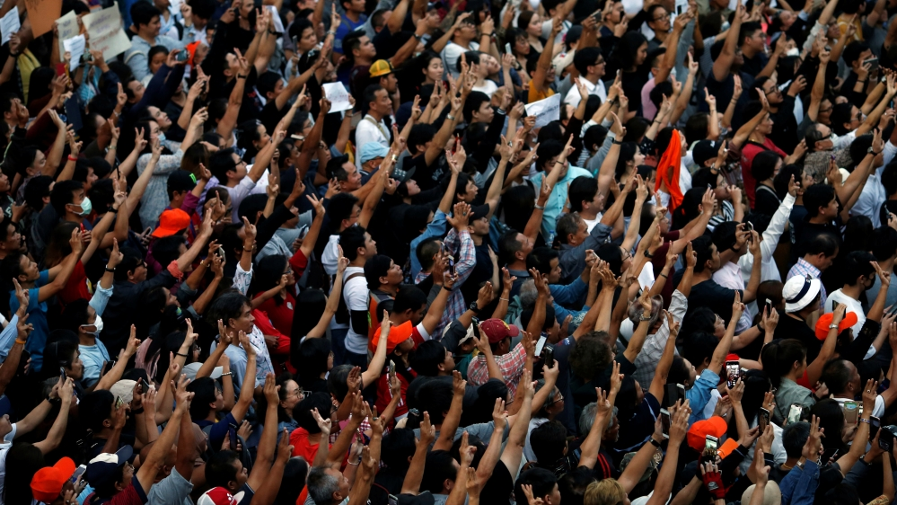 Supporters wave their hands during an unauthorised flash mob rally by the progressive Future Forward Party in Bangkok
