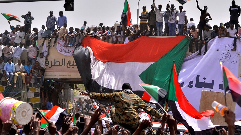 Sudanese soldier outside army HQ