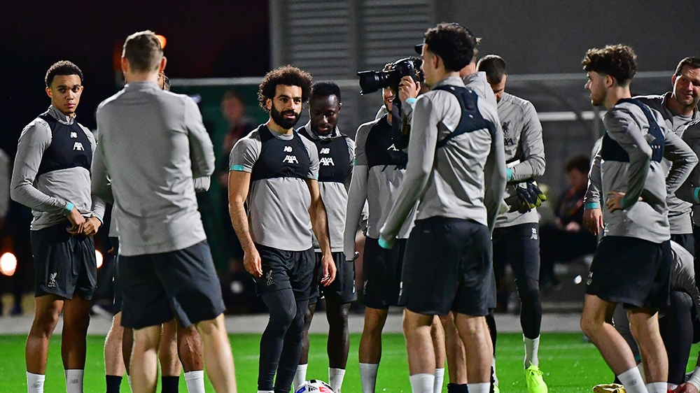 Liverpool's Egyptian midfielder Mohamed Salah (C) takes part in a team training session at Qatar University stadium in the capital Doha on December 16, 2019, ahead of the December 18 FIFA Club World C