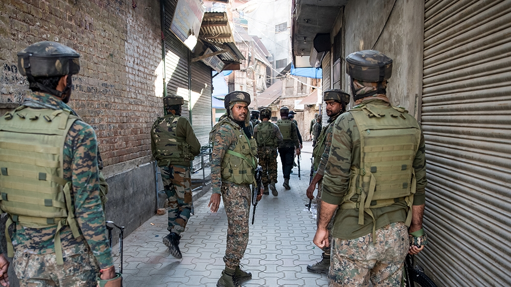 Indian paramilitary soldiers patrol during a search operation after an explosion in Srinagar, Indian controlled Kashmir, Saturday, Oct. 12, 2019. At least seven pedestrians were wounded on Saturday in