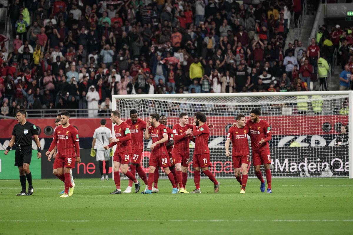 Liverpool team after scoring first goal of the match. [Sorin Furcoi/Al Jazeera]