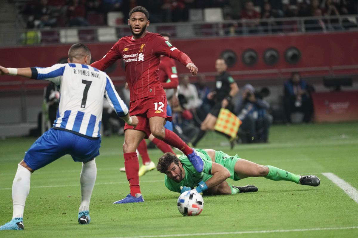 Liverpool goalkeeper Alisson Becker makes a save. [Sorin Furcoi/Al Jazeera]