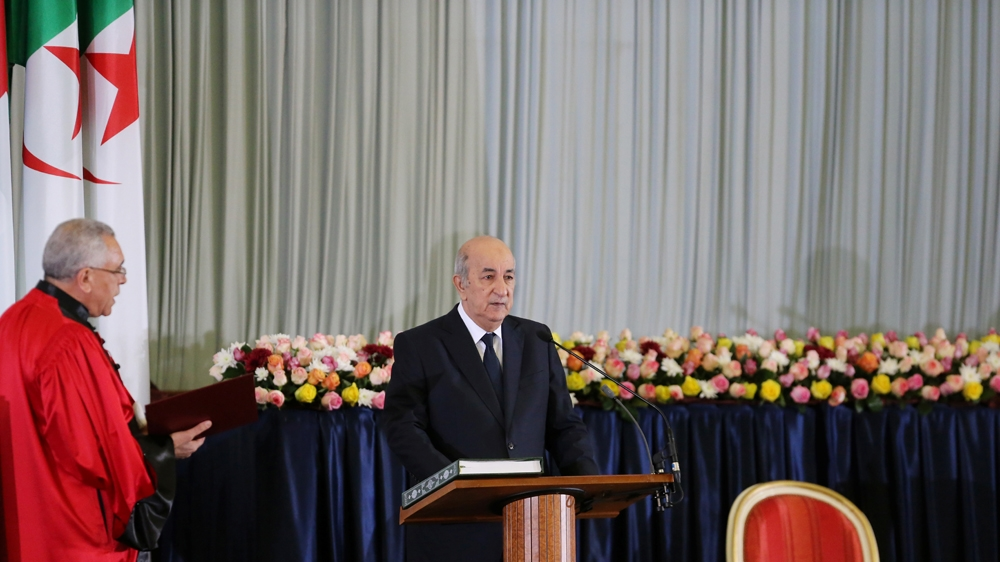 Algeria swears in new president as opposition debates response
