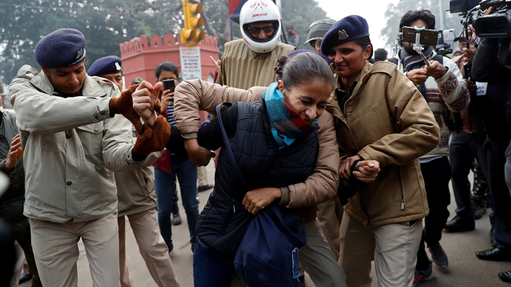 A demonstrator is detained during a protest against a new citizenship law, in Delhi, India, December 19, 2019. REUTERS/Danish Siddiqui