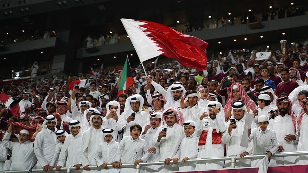 Qatari fans celebrating their team's victory over UAE [Sorin Furcoi/Al Jazeera]