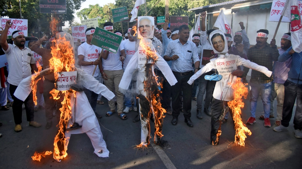 Activists from AASU burn effigies during a protest against the Citizenship Amendment Bill, in Guwahati