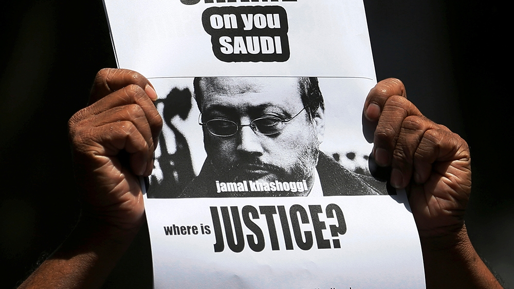 A member of Sri Lankan web journalist association holds a placard during a protest condemning the murder of slain journalist Jamal Khashoggi in front of the Saudi Embassy in Colombo, Sri Lanka October