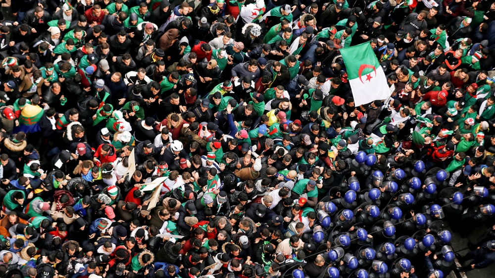 Police officers attempt to disperse demonstrators trying to force their way to the presidential palace during a protest calling on President Abdelaziz Bouteflika to quit, in Algiers, Algeria March 22,
