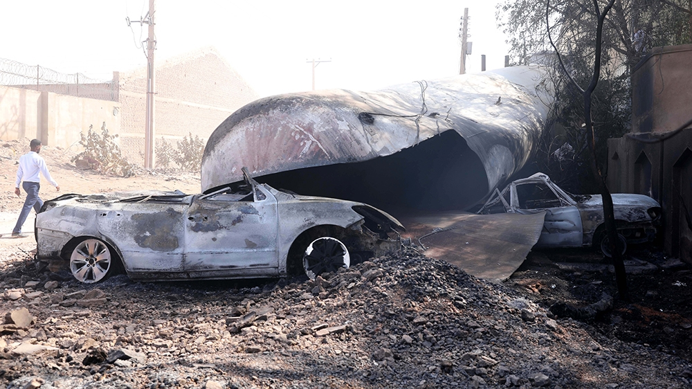 A damaged vehicle is seen at the site of a tile manufacturing unit after an explosion in an industrial zone, north Khartoum, Sudan, 03 December 2019. According to media reports quoting medical sources
