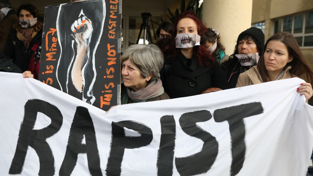 Activists take part in a demonstration, after a British woman was found guilty of faking a rape claim, outside the Famagusta courthouse in Paralimni