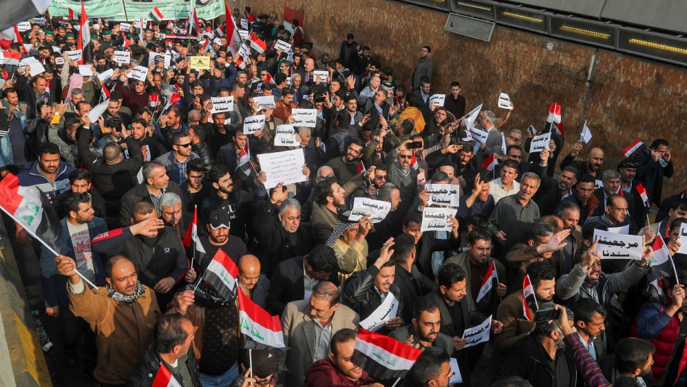 Iraqi demonstrators gather during ongoing anti-government protests in Baghdad