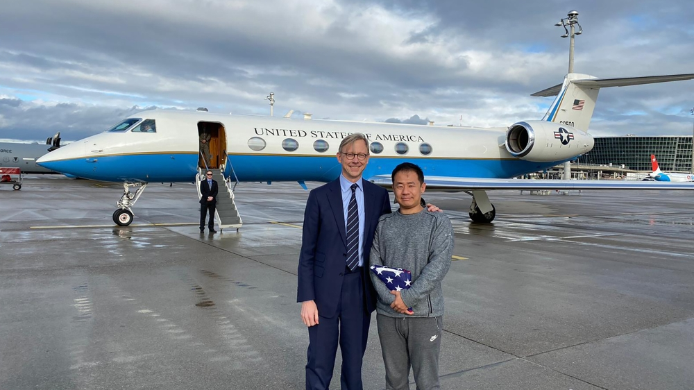 U.S. special representative for Iran, Brian Hook stands with Xiyue Wang in Zurich