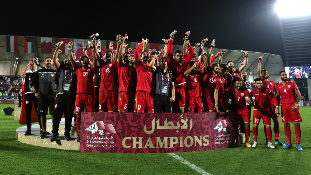 Bahrain players and coaching staff celebrate winning the Gulf Cup after the match