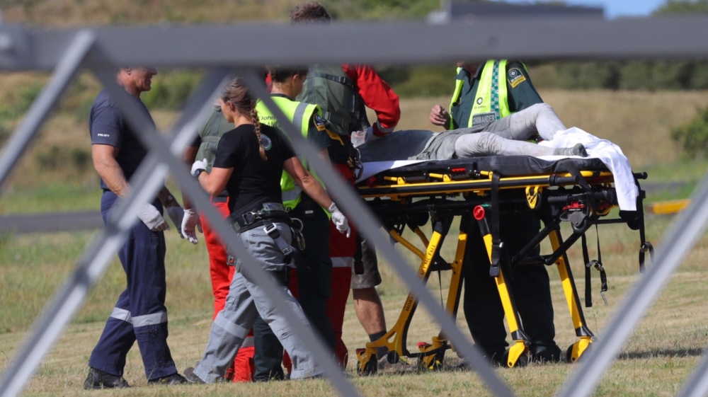 Emergency services attend to an injured person arriving at the Whakatane Airfield after the volcanic eruption Monday, Dec. 9, 2019, on White Island, New Zealand. (Alan Gibson/New Zealand Herald via AP
