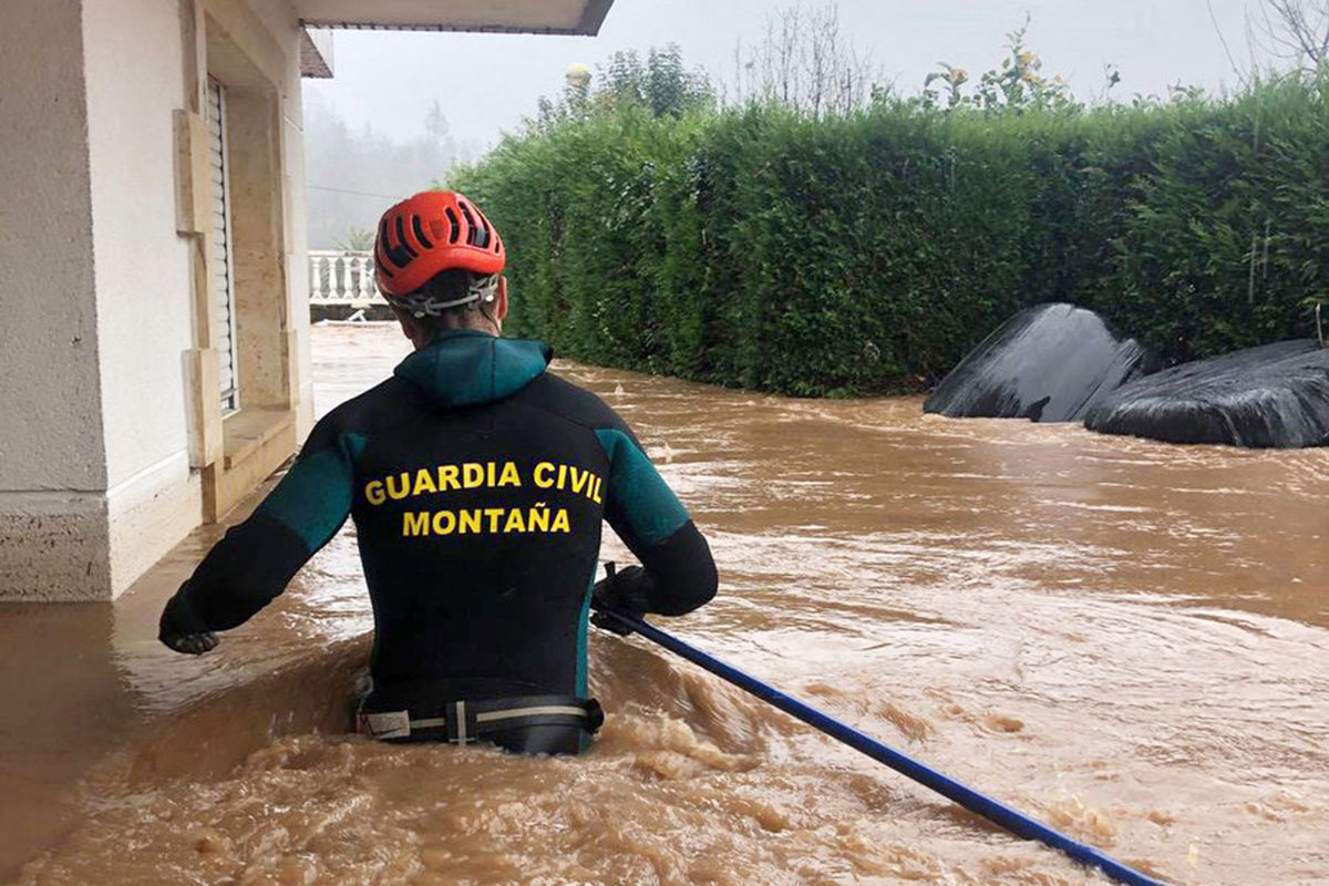 Strong storms brought heavy rainfall and flooding to parts of Cantabria, Spain, where residents needed to be rescued by Civil Guards. [Guardia Civil/EPA]
