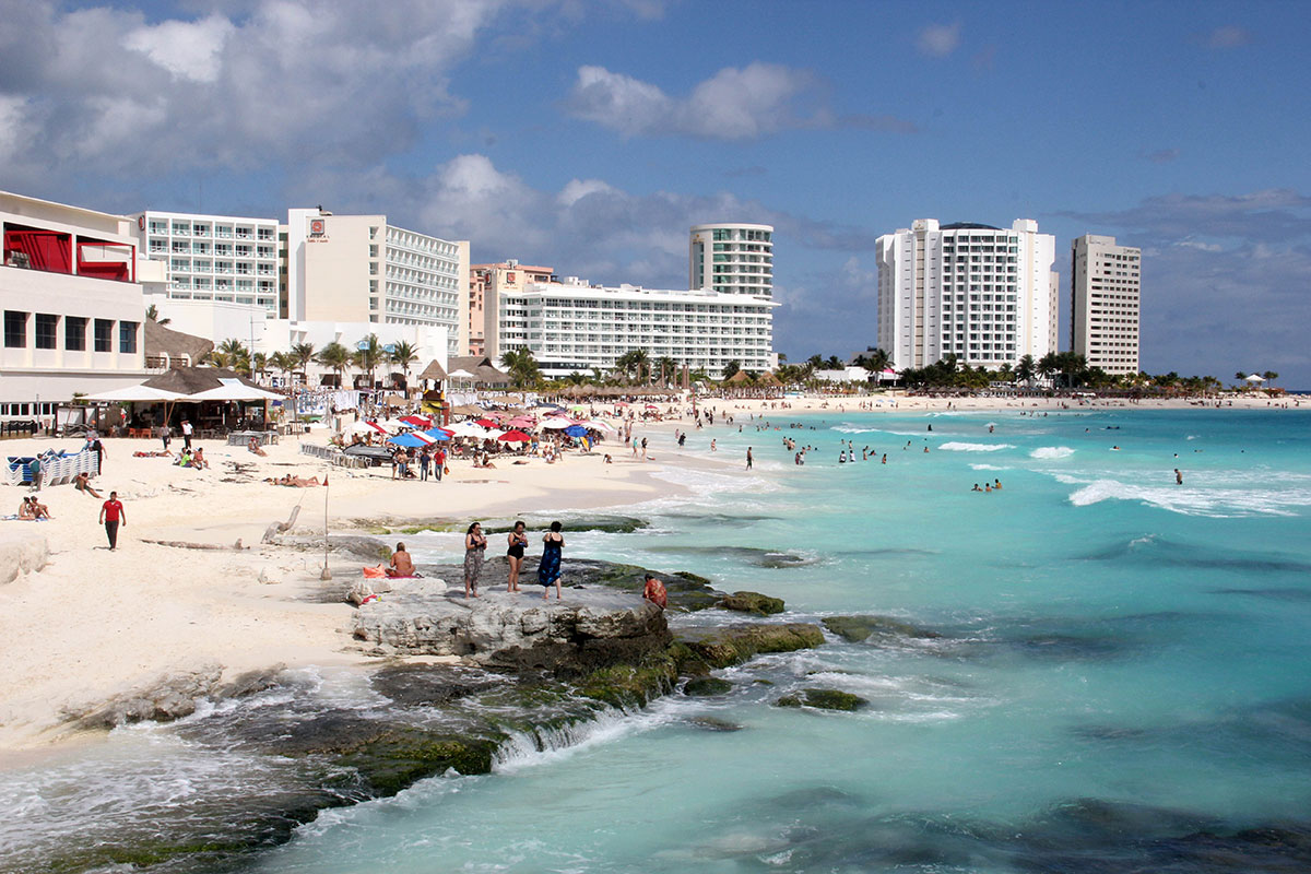 Not everyone had to bundle up in January. Here, in Cancun, Mexico, tourists flocked to the Mexican coast to enjoy some winter sun and warmth. [Alonso Cupul/EPA]