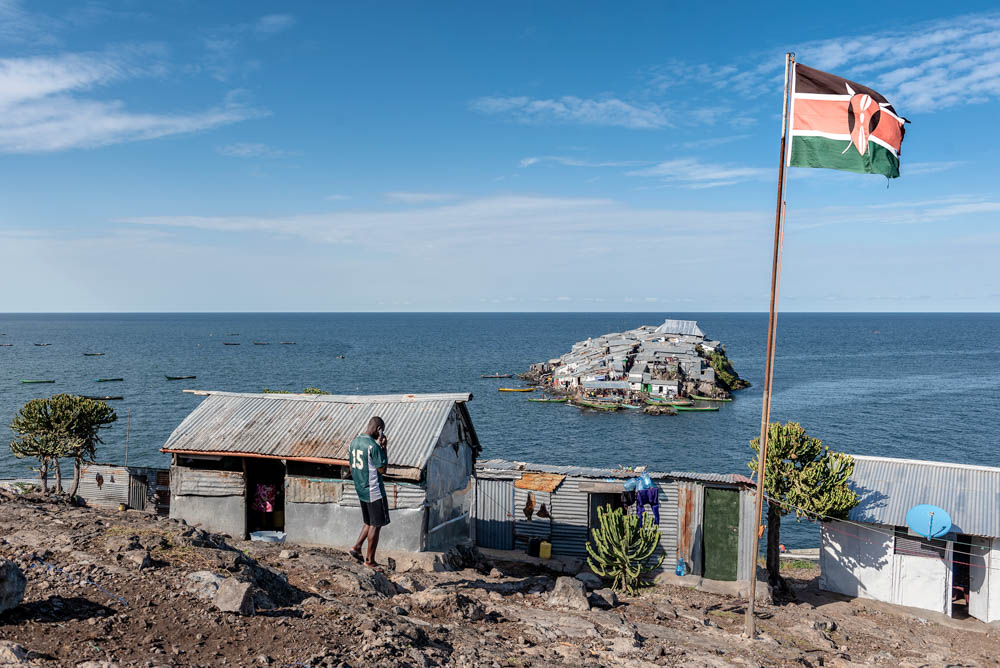 A Kenyan flag flies at the base of the Kenyan marine police station on the larger Usingo Island, overlooking Migingo Island. Kenyan police officers tried to raise a Kenyan flag on Migingo but the island's Ugandan inhabitants protested against it. The Ugandan security forces pulled the flag down despite an initial agreement for joint policing. [Jeroen van Loon/Al Jazeera]