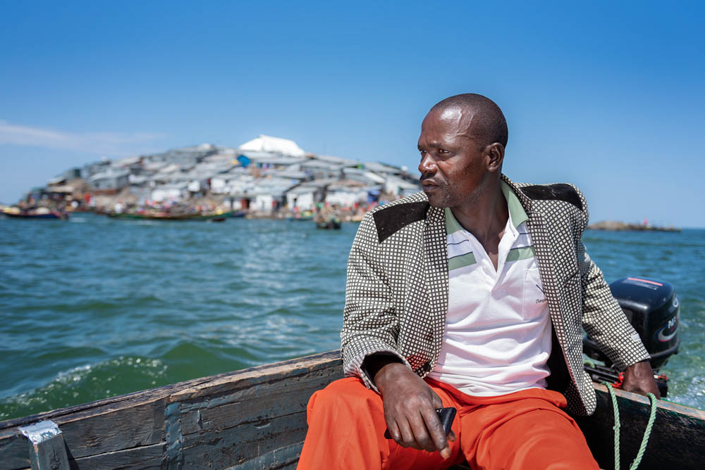 Kenyan fisherman Kennedy Ochieng, 37, heads home empty-handed. The Ugandan marine police confiscated his 300kg catch of Nile perch, along with his baits and fuel, after they accused him of fishing in Ugandan waters. [Jeroen van Loon/Al Jazeera]