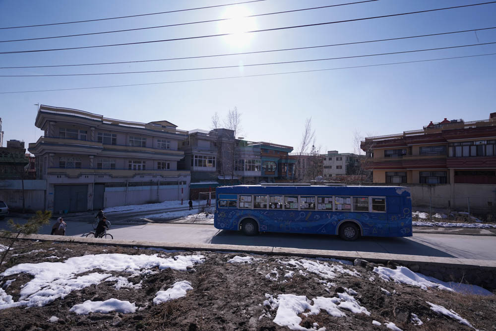 The mobile library during a scheduled stop in the west of Kabul. [Sorin Furcoi/Al Jazeera]