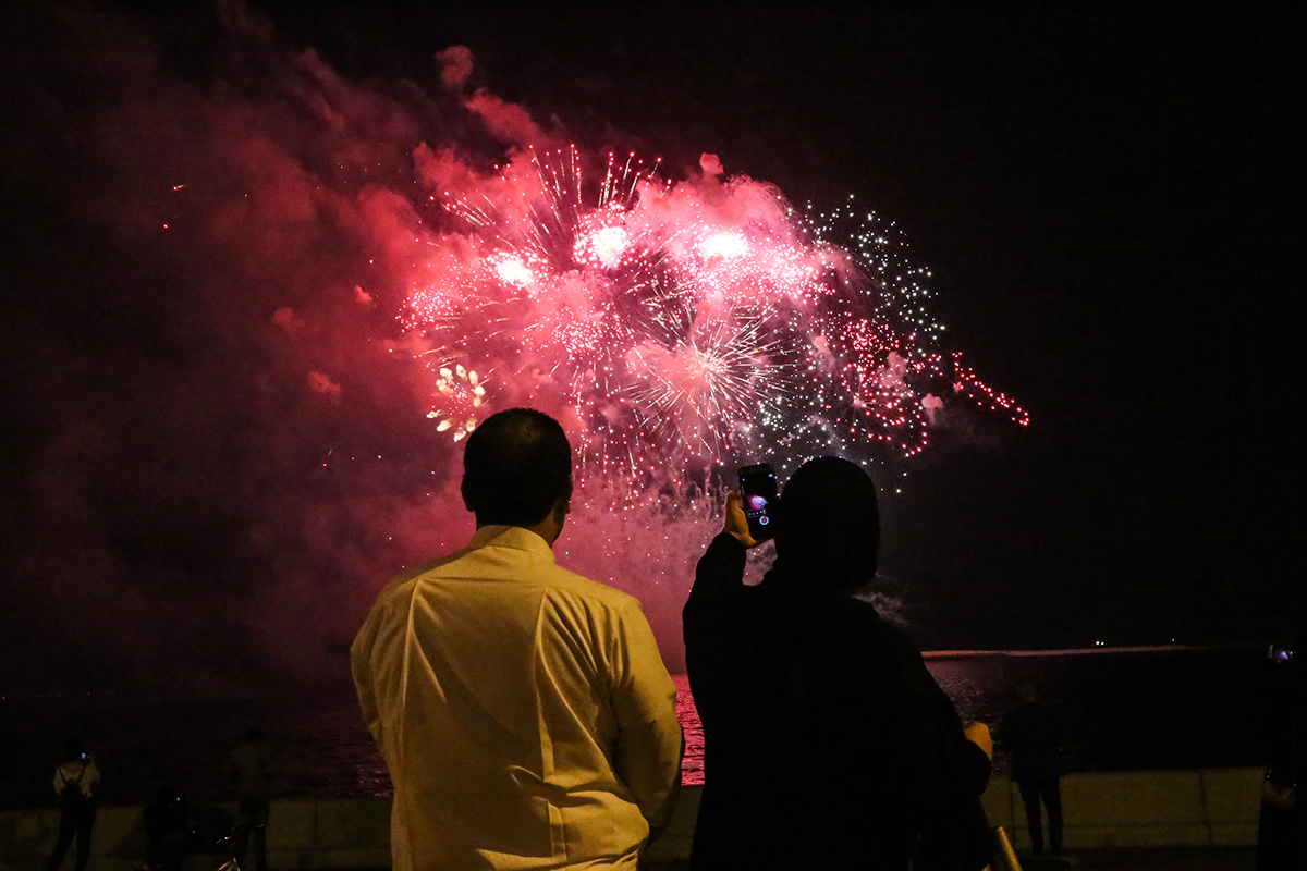 An elaborate fireworks display filled the night sky as the open-top bus made its way across Doha