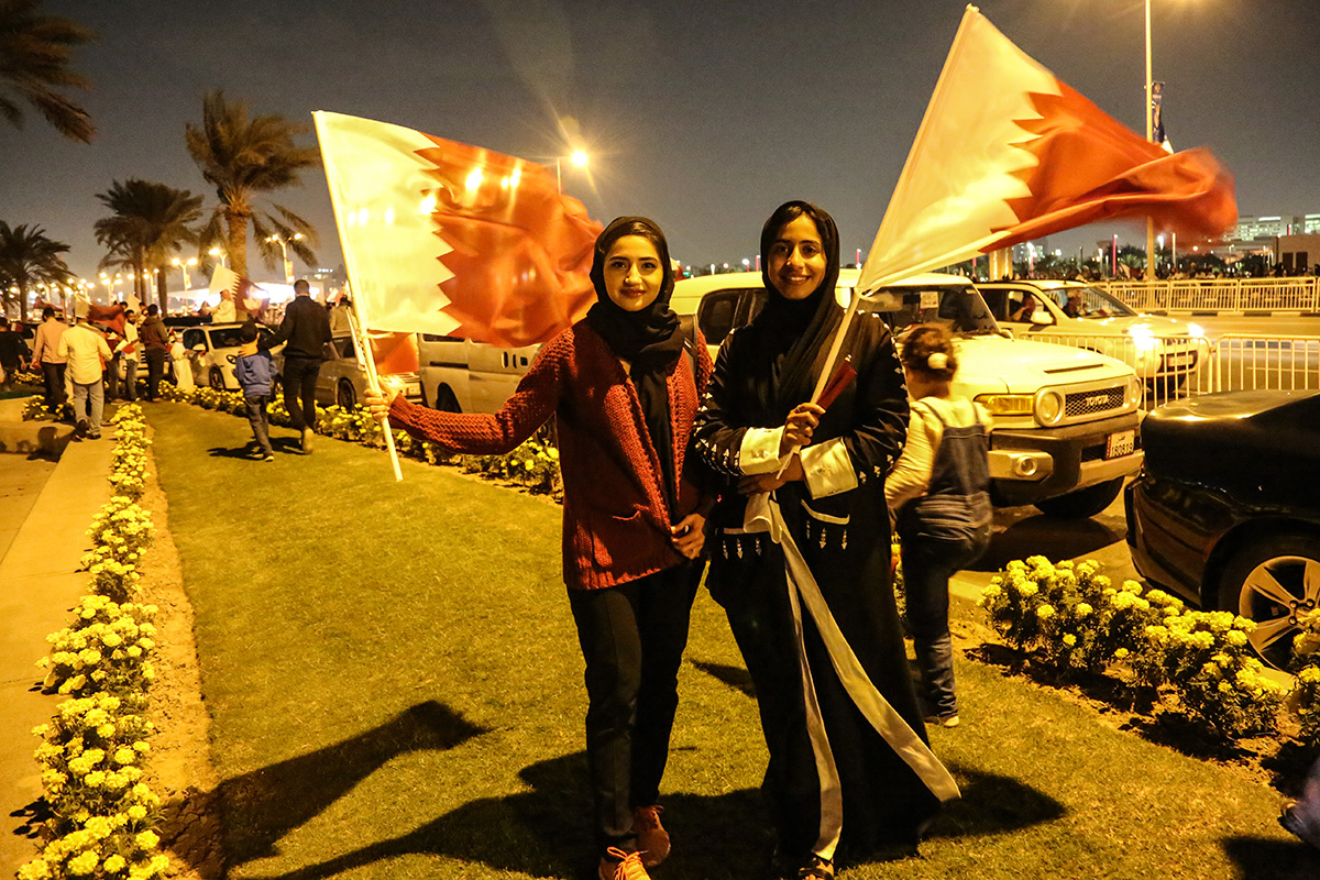 Narjes Jafarian (left) from Iran and her Qatari friend Rawda Hamad waited more than four hours for the team bus to arrive.