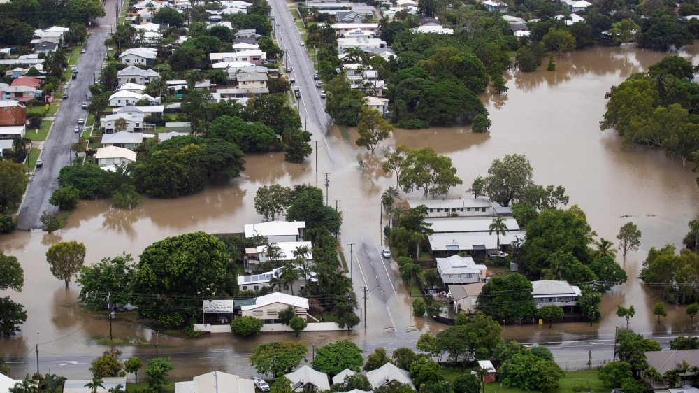 Image result for Australia PM tours flood-hit city where two men reported missing