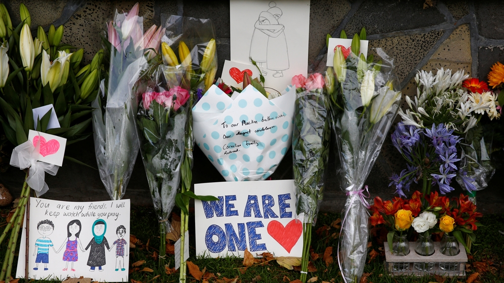 Flowers and signs at a memorial as tributes to victims of the mosque attacks near Linwood mosque in Christchurch