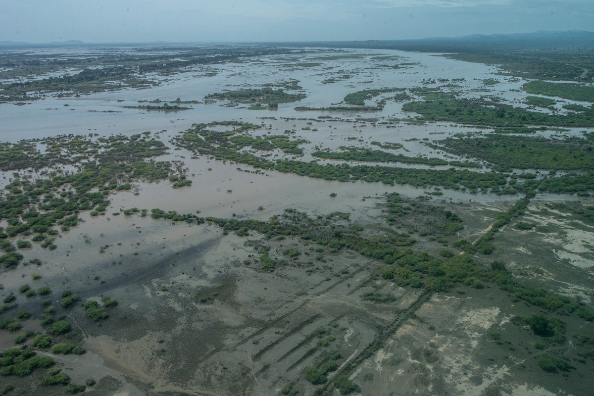 Malawi was the first country to be affected. This aerial view shows flooded land in Bangula, Nsanje district of southern Malawi. [Amos Gumulira/AFP]