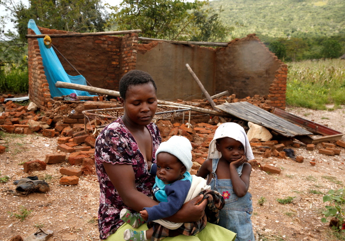 Nomatter Ncube, pictured with her children, had her family home in Chimanimani destroyed by a flash flood. [Philimon Bulawayo/Reuters]