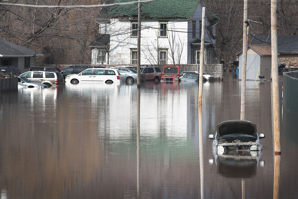 In Freeport, Illinois, cars sit in floodwater from the Pecatonica River. Several Midwest states are battling some of the worst flooding they have experienced in decades. [Scott Olson/AFP]