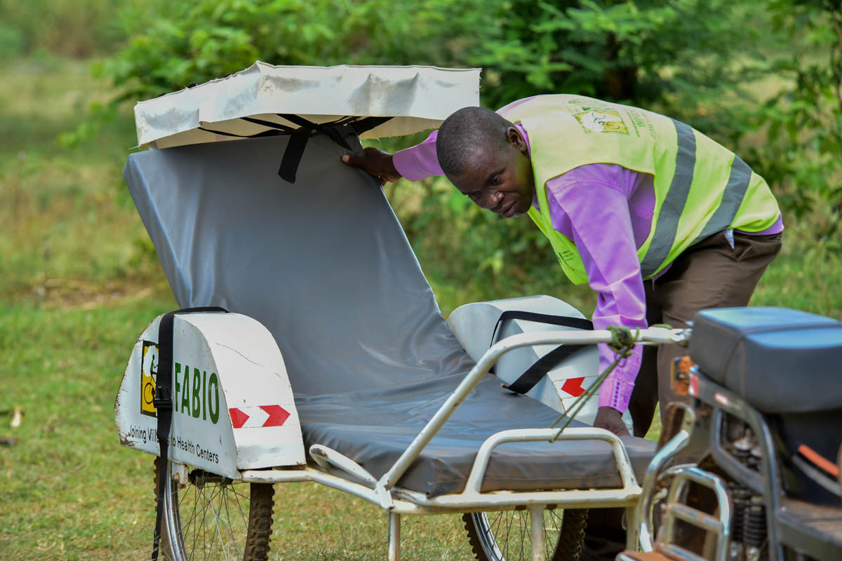The ambulances are managed by village health teams chosen from within the community. The teams distribute contact numbers so people in need can request the service. [Nicholas Bamulanzeki/Al Jazeera]