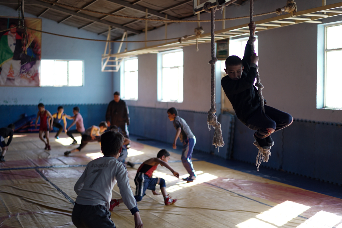The wrestling club reopened in November. The main hall is once again filled with young Afghans training. [Sorin Furcoi/Al Jazeera]