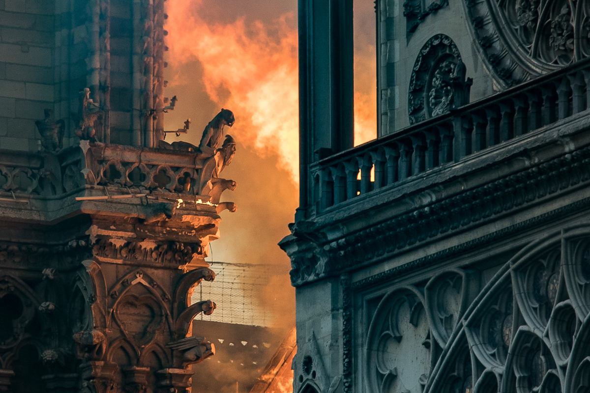 A huge fire swept through the famed Notre Dame Cathedral in central Paris on Monday, sending flames and huge clouds of grey smoke billowing into the sky. [Thomas Samson/AFP]