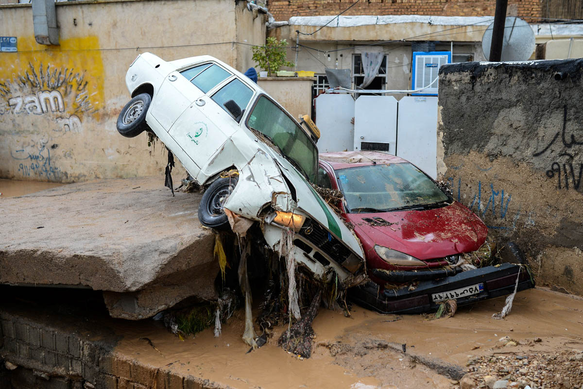 Damaged vehicles are seen after flash flooding in Shiraz, Iran. [Tasnim News Agency/Reuters]