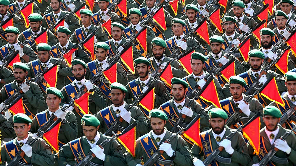 Iran's Revolutionary Guard troops march in a military parade marking the 36th anniversary of Iraq's 1980 invasion of Iran, in front of the shrine of late revolutionary founder Ayatollah Khomeini, just