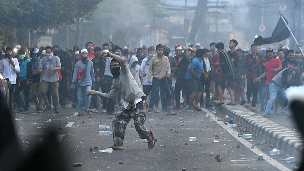 Police clash with protesters in Jakarta, Indonesia