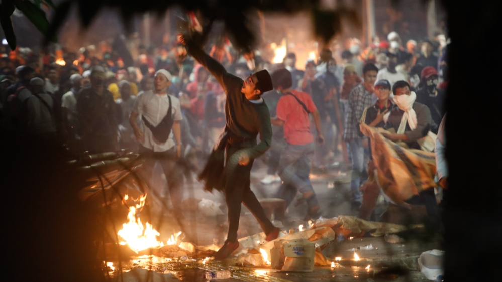 Indonesian protesters clash with the police during a protest outside of the Election Supervisory Board (Bawaslu) building, following the announcement of the presidential election in Jakarta, Indonesia