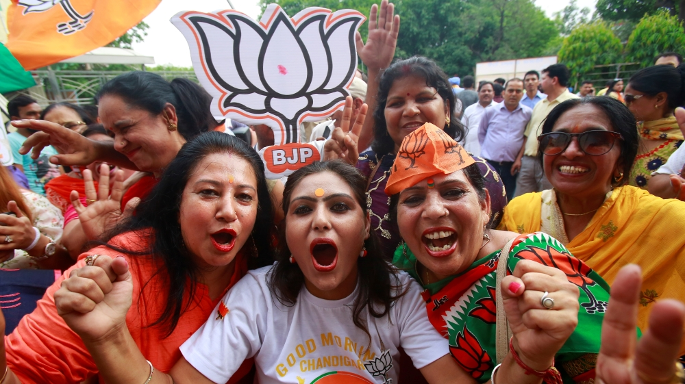 Supporters of Bharatiya Janata Party (BJP) celebrate after learning of initial poll results in Chandigarh