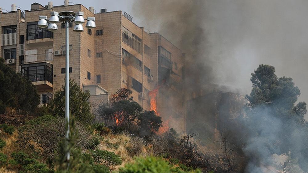 Wildfires rage in Israel during heatwave